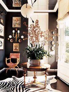 Look at the orchid on this foyer table! The dark floor, dark walls. Zebra Cowhide Rug, the glass doo Black Painted Walls, Dark Walls, Top Interior Designers, Interior Design Living Room, Interior Livingroom, Chocolate Walls, Decoration Inspiration, Inspiration Wall, Decor Ideas