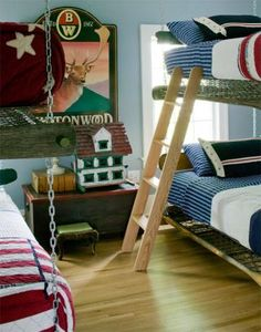 This room was made for sleepovers! Two sets of bunkbeds are suspended from the ceiling rafters with heavy chain, and the mattresses sit right on the open springs. American-themed accessories make the room clean and crisp, with a bit of adventure. Whether used as a bedroom for brothers, an overnight space for friends, or a cousins' room at the grandarents' house, this is a room that lets boys be boys!