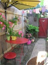 Cool Tami's New Orleans Courtyard My old court yard- everything is recycled- even the umbrella that I cut in half and mounted to the fence.My old court yard- everything is recycled- even the umbrella that I cut in half and mounted to the fence. Small Courtyard Gardens, Small Courtyards, Small Backyard Gardens, Backyard Garden Design, Small Patio, Courtyard Ideas, Small Fence, Court Yard Garden Ideas, Side Gardens