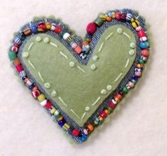 Heart Brooch. This would be a cute little something to tuck in a stocking or surprise ball.