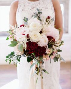 Brides bouquet, large , lush, loose , romantic , garden style , fragment, blush peonies, burgundy roses, white roses, astilbe, peach stock, berries and euck. photo by Angela Janette Photography