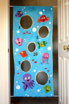 Bean bag toss.  DIY crafts for summer fun, games, activities & kid birthday parties.  Design the game to match your theme.