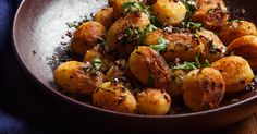 Crisp double-cooked baby Yukon Golds with garlic and parsley for a simple but memorable side.