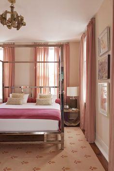 A four-poster chrome bed surrounded by shades of pink and peach, Angie Hranowsky