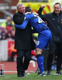 Robin van Persie and Sir Alex Ferguson celebrating his goal with a hug.