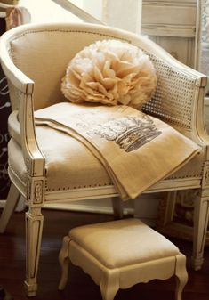 My favorite re-do of barrel back cane chairs so far, the darker detail areas really chic it up.  The neutral color is versatile,maybe use linen?