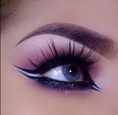 love this. dramatic and spaced out lashes. with highlighted and smokey eye. white liner and black glitter