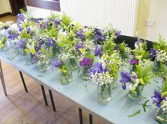 Re-purpose jelly jars, bottles, mason jars, etc. for centerpiece vases...