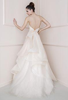 Brides: Antonio Riva. Light pink triple organza wedding dress with soft ruffled back.