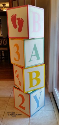 ABC blocks painted and stenciled for a baby shower. LOVE these!  would be perfect for taking those monthly photo update pictures!