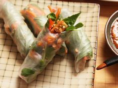 The real key to these great spring rolls is to balance the textures and flavors of the ingredients inside the soft, stretchy rice paper wrapper. For this version, I'm using tender pea shoots, along with carrots cut into a fine julienne, crispy marinated tofu, herbs, chilies, and toasted peanuts.