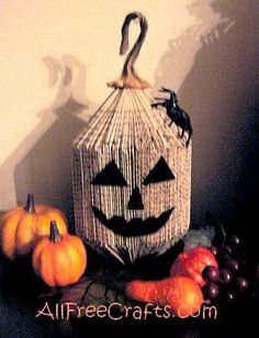 Make a recycled paperback book pumpkin by folding a book into a plump, fanned pumpkin shape and decorating with a paper or felt face. Halloween Arts And Crafts, Halloween Books, Fall Crafts, Halloween Fun, Holiday Crafts, Old Book Crafts, Book Page Crafts, Paper Crafts, Book Folding Patterns Free Templates