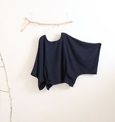 over size wool top fit waist/hip 58 and under. ready to ship. ********************  material: soft navy wool ( 100%) This fabric is quite