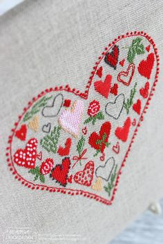 lovely cross stitched heart full of hearts