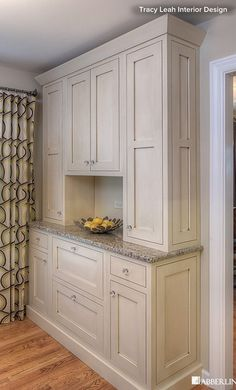 Burnished finish. Applied after this unit was painted, a burnished finish gives it an aged look. Each cabinet is distressed, sanded and then applied with a burnishing stain.