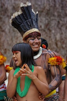 Young Kuikuro indians dancing and singing at Toca da Raposa in São Paulo, Brazil