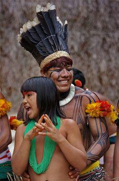 Young Kuikuro indians dancing and singing at Toca da Raposa in São Paulo, Brazil