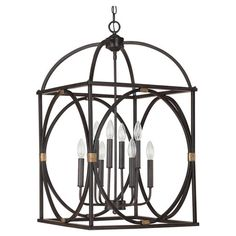Illuminate your foyer or dining room in elegant style with this eye-catching metal pendant, featuring an openwork design and a French oak finish.