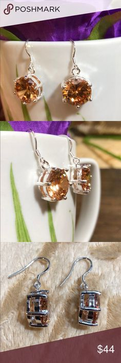 Yellow-Orange Citrine Silver Drop earrings. I can't say enough how stunning these earrings are in person. No matter what angle you are looking at- there is always so much sparkle and bling.   These are gorgeous and can be worn casual and dressy. Bondhu Jewelry Earrings