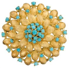 A turquoise and eighteen karat gold brooch designed as a foliate motif with florentine finished gold accented by cabochon turquoise; Italian assay marks.