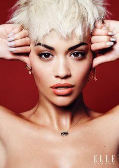 Rita Ora looks fashion forward with a platinum blonde pixie haircut