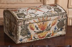 Beautifully painted, this antique Swedish antique box was handmade from wood and designed to store keepsakes.  With such folk art decoration on the exterior, it could be left on a table, buffet or vanity for all to appreciate.  Humpback top is similar to steamer trunks so made to keep from being loaded into the ship at the bottom of the stack... Rare condition and charm.  Circa 1880s.