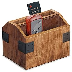 Don& lose track of all of your remote controls. Instead, use the Wood Remote Control Caddy to keep all of you remotes organized and ready for action at the drop of a hat. It& stylish to boot, with a nice oak finish and neat metal accents. Remote Caddy, Remote Control Holder, Wooden Decor, Wooden Diy, Wooden Crafts, Small Woodworking Projects, Wood Projects, Nomadic Furniture, Diy Furniture