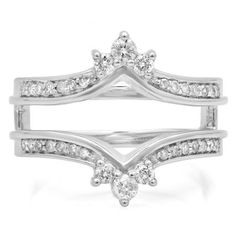 An elegant, vintage-inspired way to showcase her diamond solitaire, this exquisite wrap is a sparkling delight. Fashioned in 10K White Gold, this unique double design features trios of white diamonds that create 'tiaras' around her solitaire. The double shank sparkles with additional diamonds. Radiant of diamonds, this ring guard is finished with a bright polished shine.