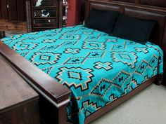 """Our Luxury Southwest Bedspreads feature new El Paso Saddleblanket designs in vibrant, classic Southwest colors. Made from high quality acrylic, they incorporate a fine weave and a double-ply heavyweight material.  Imported. Done in a Turquoise Classic Southwest design.  KING SIZE 114"""" X 96"""""""
