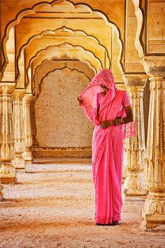 Beautiful Hindu woman at Amber Fort temple in Rajasthan Jaipur India by David Davis