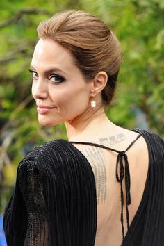 LONDON, ENGLAND - MAY 08: Angelina Jolie attends the 'Maleficent' Costume And Props Private Reception at Kensington Palace on May 8, 2014 in London, England. (Photo by Dave J Hogan/Getty Images)