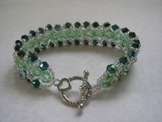 Lt green and dk green crystal flat spiral bracelet  $25