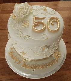 golden wedding anniversary cake with sugar flowers and royal iced piped details Golden Anniversary Cake, 50th Wedding Anniversary Cakes, 50 Anniversary, Wedding Cake Roses, Wedding Cake Toppers, Wedding Cakes, Wedding Flowers, Wedding Rings, Bolo Floral