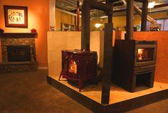 Woodstove pentagon burning display. Vermont Castings Defiant in bordeaux porcelain enamel, Regency Alterra contemporary wood stove.