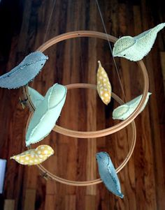 Use left over fabric scraps to sew small birds, then add them to embroidery hoops to create a mobile.