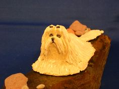 OOAK sculpture front view Maltese laying on stone base