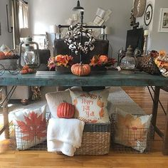 # @mrs.courtney.mussina Why hello Fall! You have arrived in glorious splendor in this home! We love how you've styled your table for fall. The fabulous fall colors and textures perfectly compliment the rustic finish of the table, and those pillows arranged in baskets beneath are awesome! What a way to welcome everyone into your living room. Thank you for sharing this view, and for including Antique Farmhouse products in your home. Happy Fall Y'all!⠀ ⠀ #myafh #antiquefarmhouse #livin...