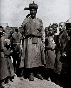 National Geographic photographer Roy Chapman Andrews took this photograph of 7 foot five inch man in 1922 in Ulaanbaatar. The photograph was never published in the magazine.