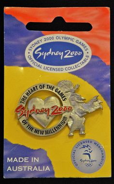 A commemorative pin featuring the Olympic Mascots, and the following text: Sydney 2000, The heart of the Games of the New Millennium. Pins became a popular collectable item during the Sydney 2000 Olympic Games, and during the Games a Central Sydney Popular @ Pinterest