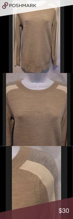 """J CREW Stripe Sleeve Merino Wool Preppy RARE Awesome J Crew pullover has vented sides, is 100% Merino wool, 12 gauge knit, hits at the hip, comfortable and flattering. It has a crew neck, stripped down the sleeves and great beige, ivory and gray. Beautiful. Classic.    All measurements are taken while garment lays flat:  Armpit to armpit 17.5"""" Under arm length 17"""" Back length 23.75""""  Bin 112E  Please check measurements against a like item in your wardrobe. I take several measurements but if…"""