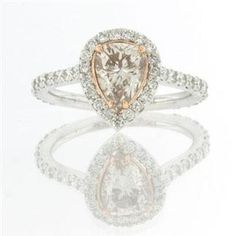 My Engagement Ring. Fancy Light Pink Brown Diamond in a rose-gold basket. Pure heaven!
