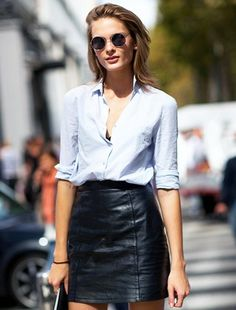 Thanks for the inspo, Irina Kulikova! Model Irina Kulikova was snapped on the streets of Milan in a cool leather skirt look that we can't wait to try! We admit there are times that we are a bit intimidated by leather skirts, since they can often come across more edgy than polished, but Irina shows that a balance can be found with a few key pieces. Her round metal sunglasses, classic blue button-down shirt and suede ankle boots, give her skirt a relaxed, yet sexy feel that is just what we are…