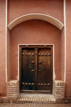 """photo by Lida Arzaghi on Flickr                          A persian old door...  An old door in """"Abyaneh""""  A very old door with beautiful female and male door knockers and knobs."""