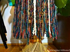 multi colored rasta inspired yarn skirt. A fun way to add color and texture to boho decor.