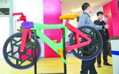 A man named Mr. Mei was on hand to showcase a 3D printed plastic bicycle unlike anything we have seen in the past. Built almost entirely of 3D printed plastic parts, it featured a bright green and pink frame, orange seat, red handlebars, black wheels and purple tires. It was all created using a 3D printer that cost him just 10,000 Chinese Yuan ($1612).