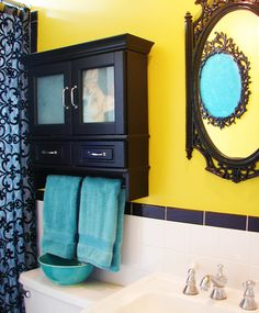 I like the yellow & turquoise combo for a bathroom, but would use brown instead of black and put more of a rustic spin on it.
