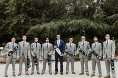 Love the punk 90s inspired skateboards in this groomsmen navy and grey wedding party | image by Kristen Victoria Photography