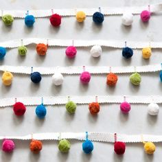 Multi Coloured Pom Pom Trim that is so bright and cheerful. Perfect for trimming curtains, blinds, cushions and other soft furnishings.