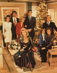 Falcon Crest:  Pilar Cumson, Lance Cumson, Emma Channing, Richard Channing, Joseph Gioberti, Angela Channing and Chao-Li. Maggie Hartford Gioberti Channing and son