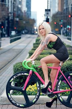 In the pink. Must be damn hard riding a bike in heels.
